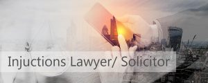 injunctions laywer and solicitor in london. photo of lawyer sat in an office in london.
